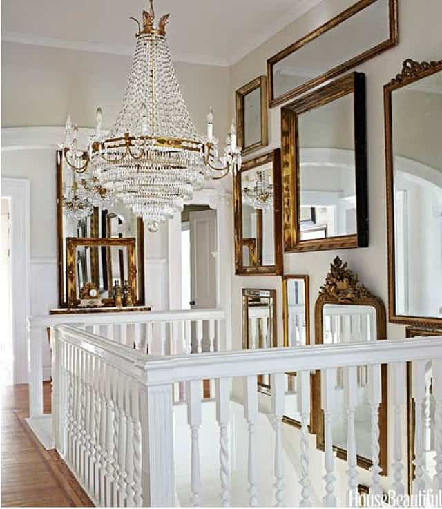 Foyer filled with vintage gold framed mirrors to make it look larger and brighter
