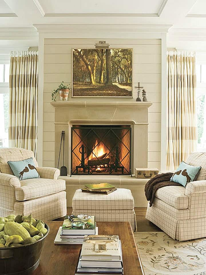How to decorate a living room with neutral decor, striped curtains and fireplace focal point