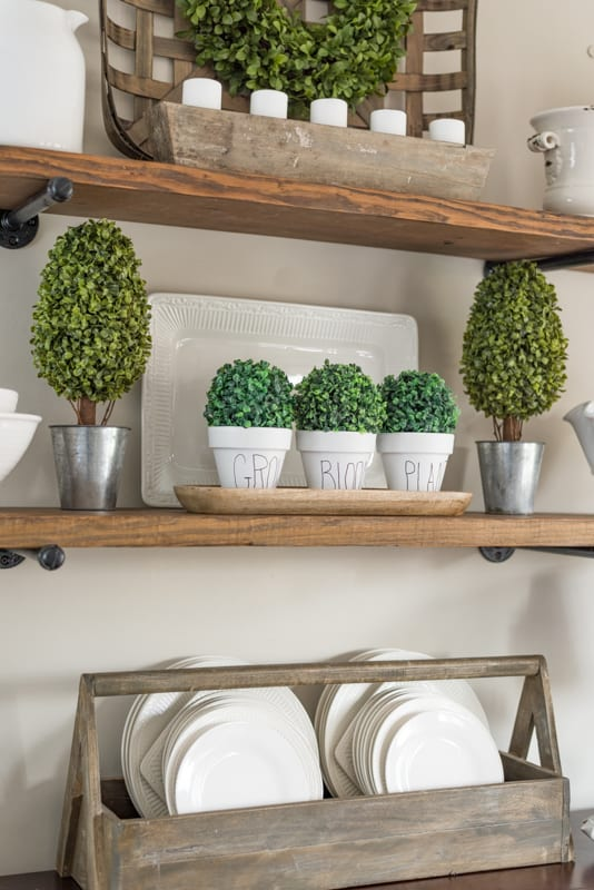 open shelves decorated with white accessories for spring