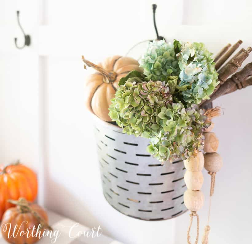 hanging metal bucket filled with fall decorations