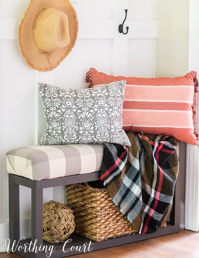 bench with fall pillows and plaid fall throw blanket
