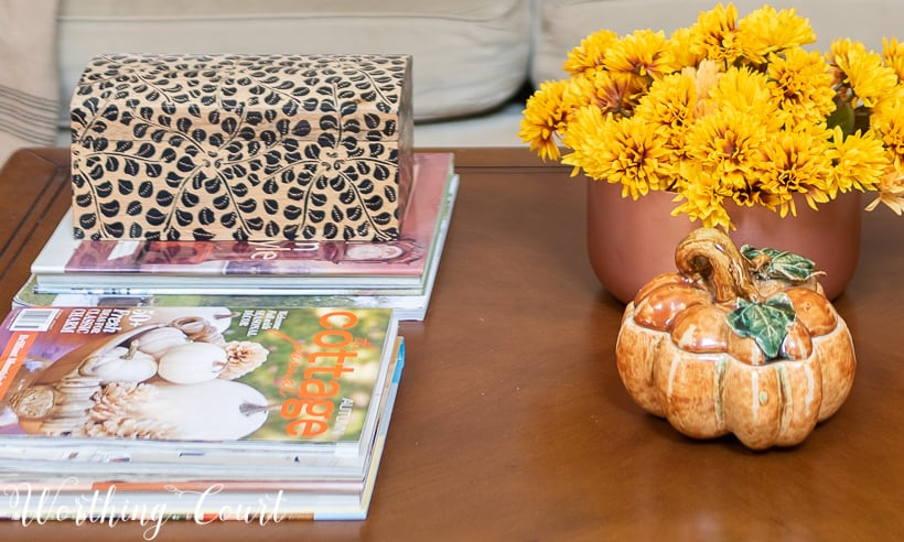 coffee table with mums and pumpkin for fall