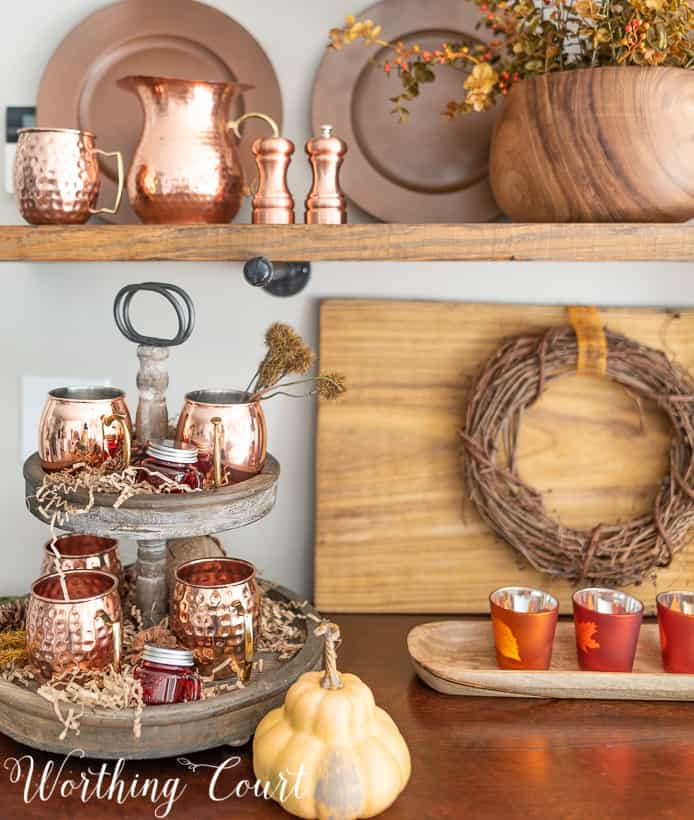 shelves decorated with copper accents for fall