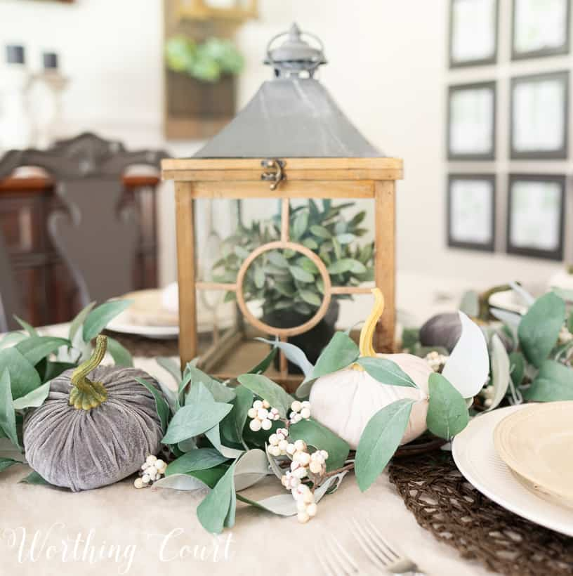 eucalyptus garland centerpiece with gray and white velvet pumpkins