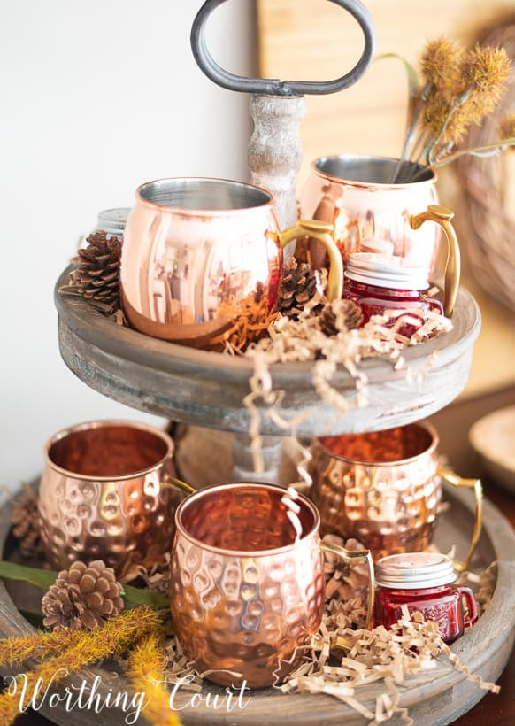 fall decor with a two tiered tray with copper Moscow mule mugs