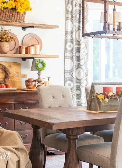 open shelves decorated with copper accents for fall