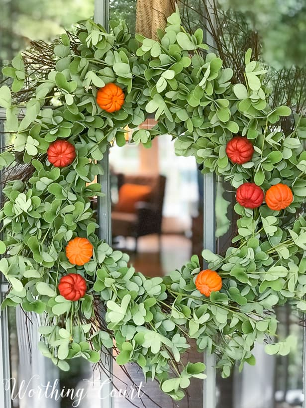eucalyptus fall wreath with faux pumpkins
