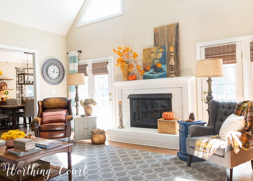 family room decorated for fall with traditional fall colors