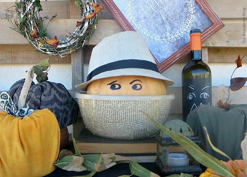 Halloween pumpkin with a hat on in a bowl