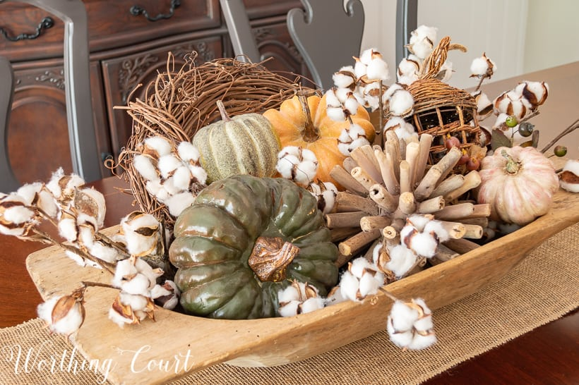 dough bowl centerpiece fill with fall pumpkins