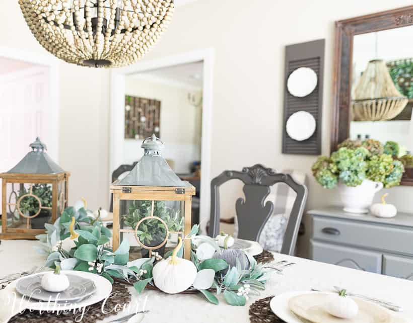 dining room decorated for fall with eucalyptus