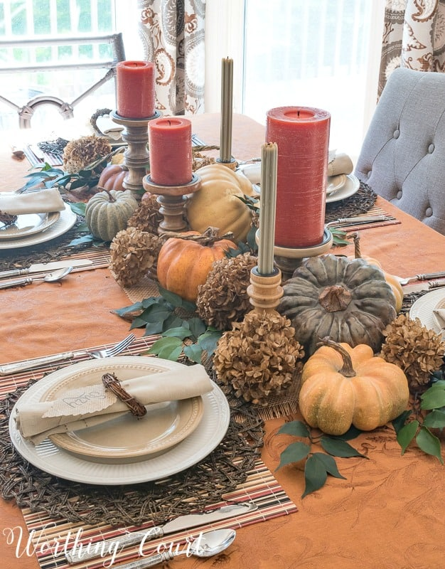 fall centerpiece display with pumpkins and candles