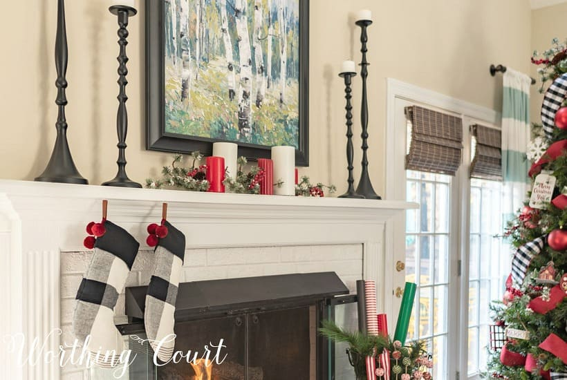 Mantel decorated for Christmas with red, white, green and black