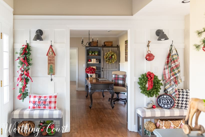 Christmas foyer decorations with plaid and greenery.