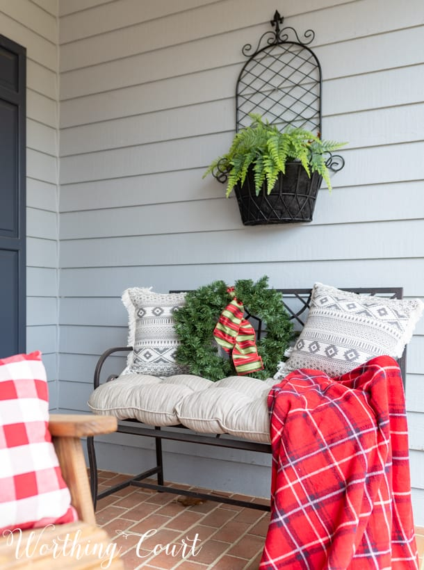Outdoor bench with Christmas decor.