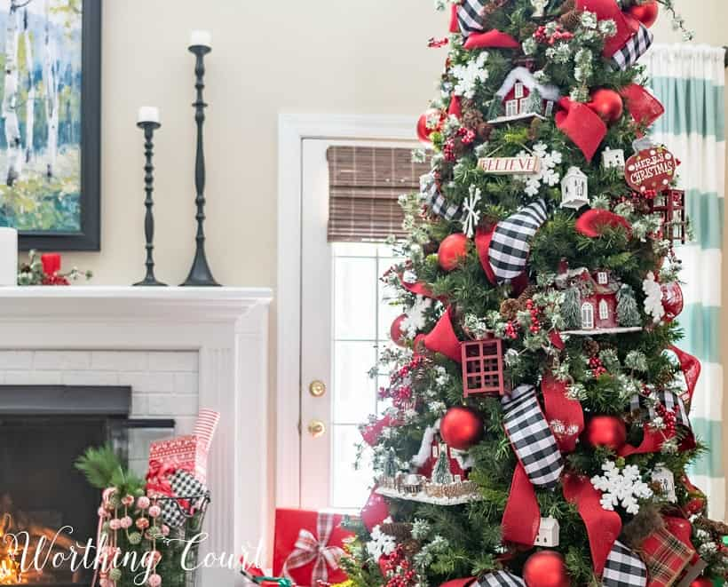 Christmas tree with red, black and white decorations.