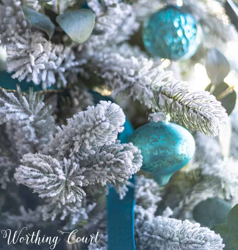 Up close look of the flocking on the tree and the teal ornaments.
