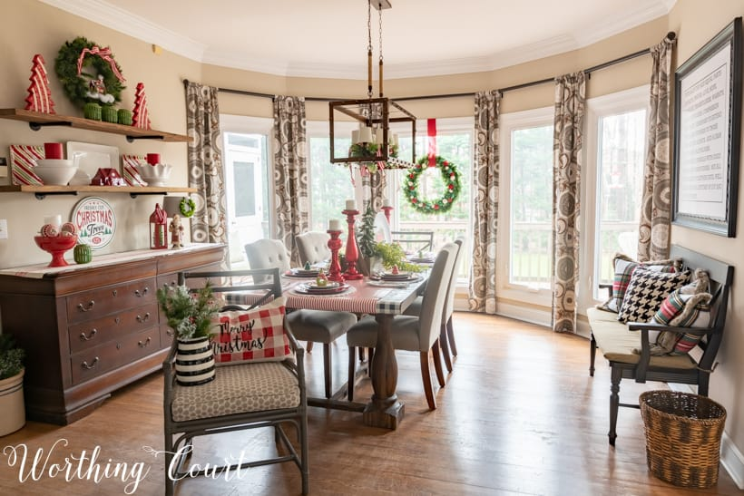 Festive Christmas tablescape with red, green and white in the dining room.