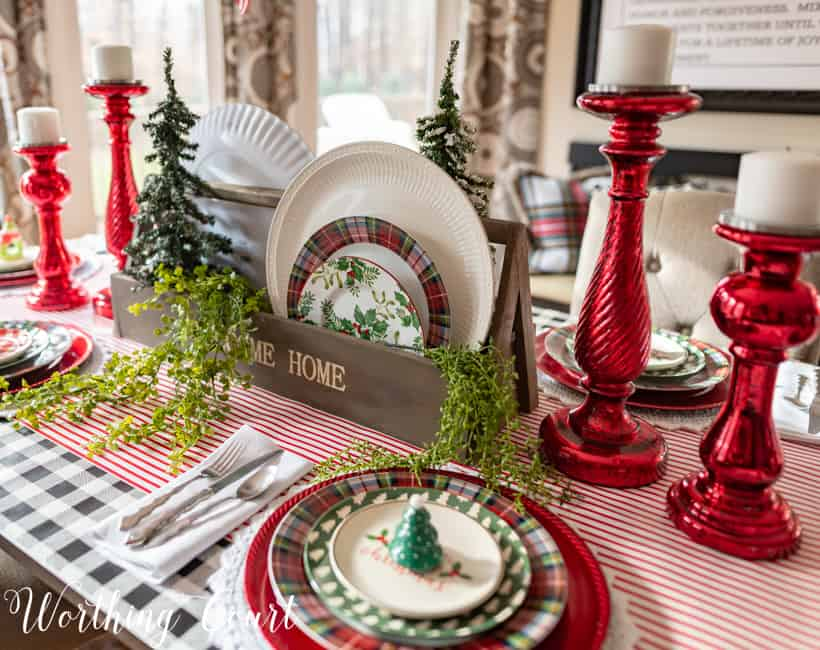 A wooden box filled with Christmas plates.