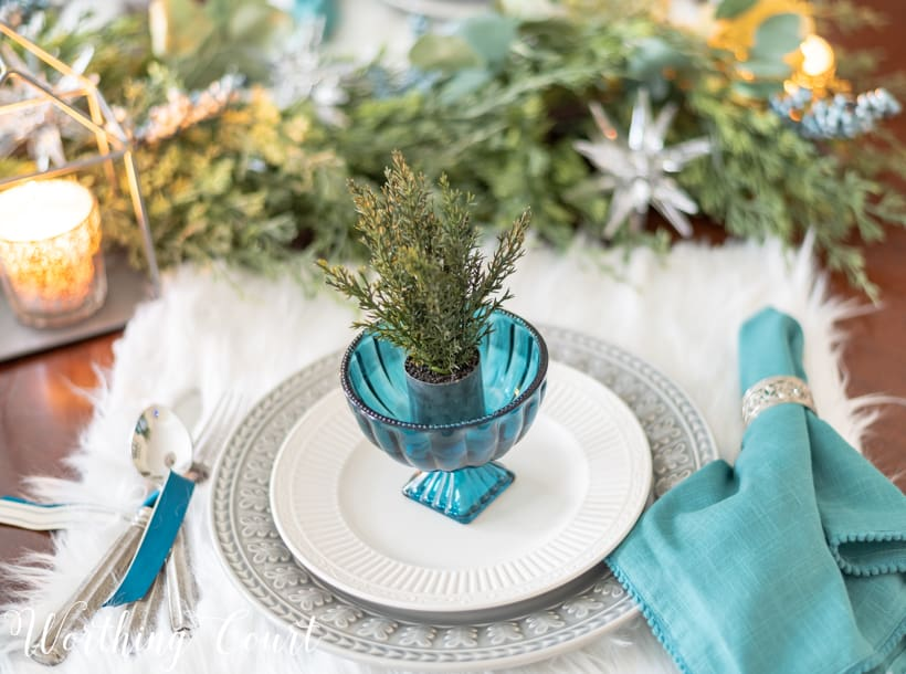 Christmas table setting with faux fur placemats