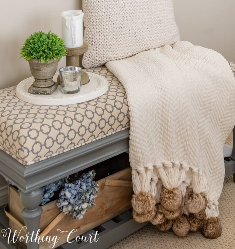 bedroom bench with pompom throw