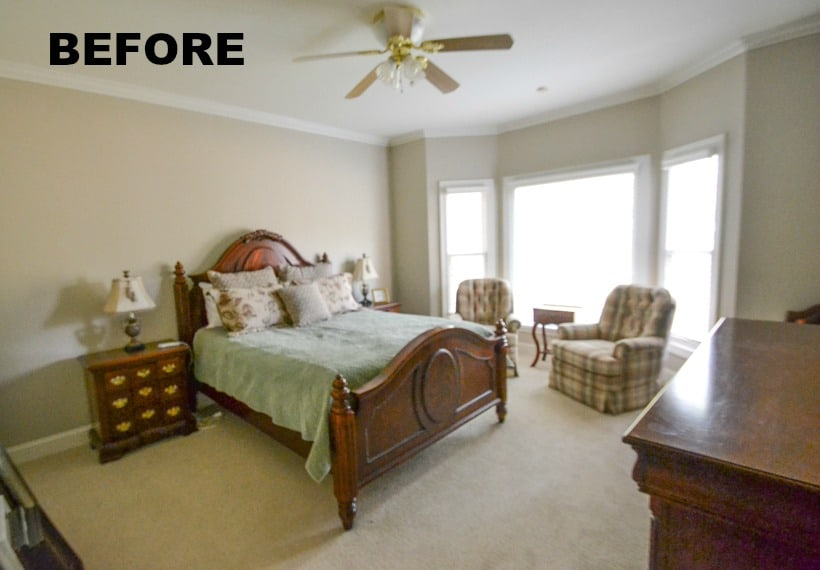 The bedroom before with a ceiling fan.