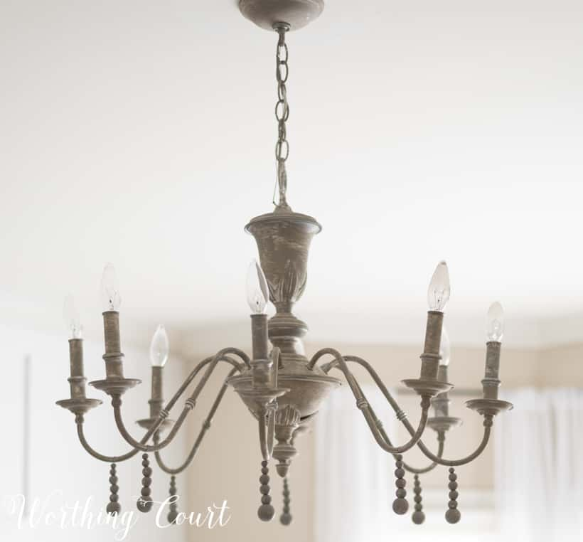 chandelier painted with beige, gray and white paint