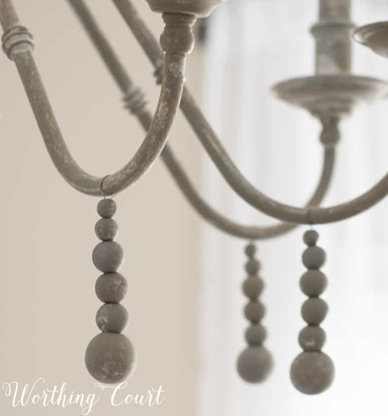 wooden beads added to a chandelier