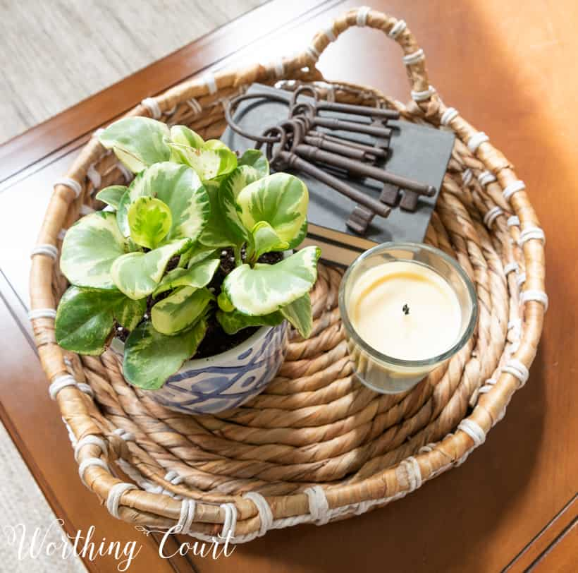 round wicker tray on a coffee table