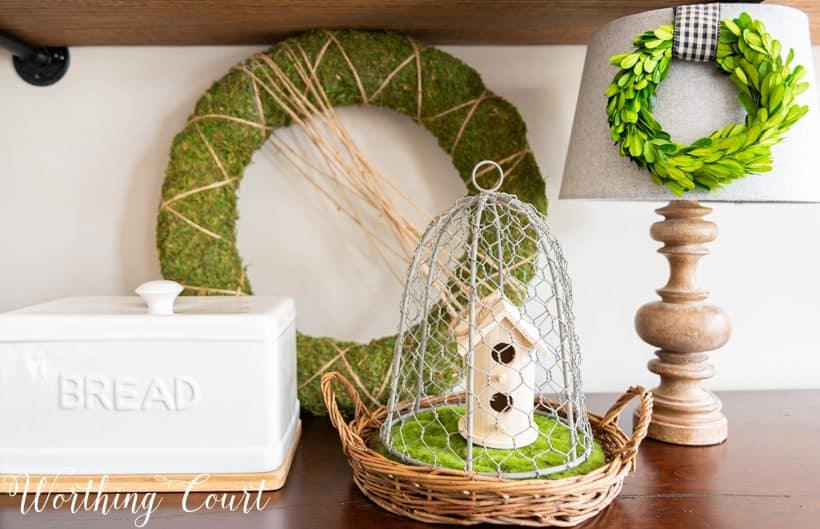spring vignette with greenery and natural wood elements