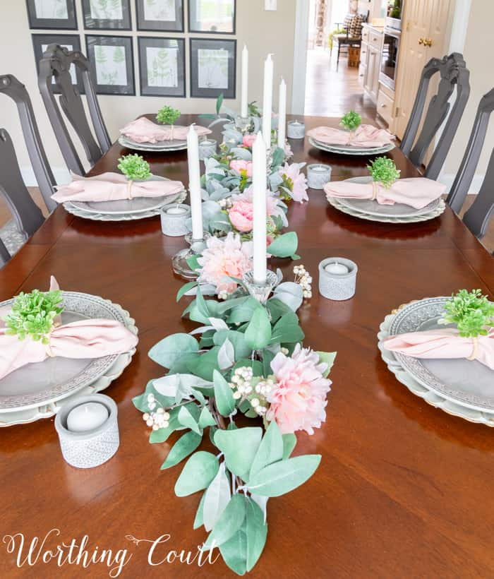 dining room table with eucalyptus centerpiece