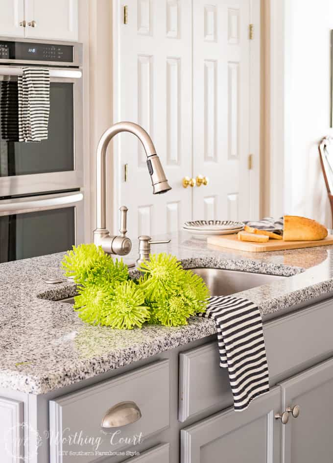 kitchen sink with bright green flowers