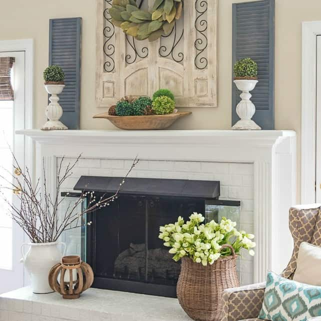 white fireplace decorated for spring
