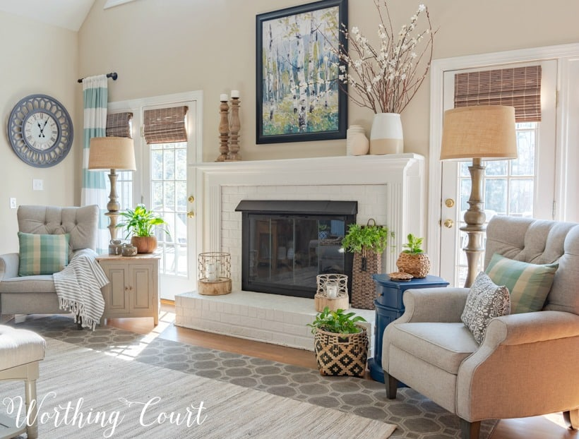 two gray recliners flanking a white brick fireplace