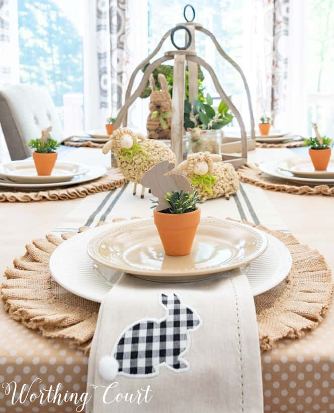 Easter place setting with a round burlap placemat