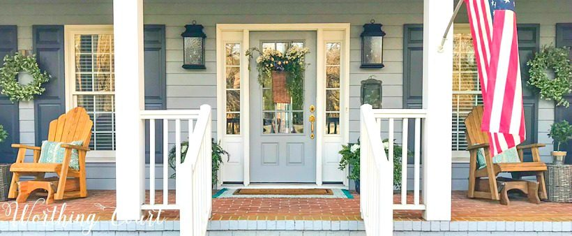 front porch with gray door with sidelights