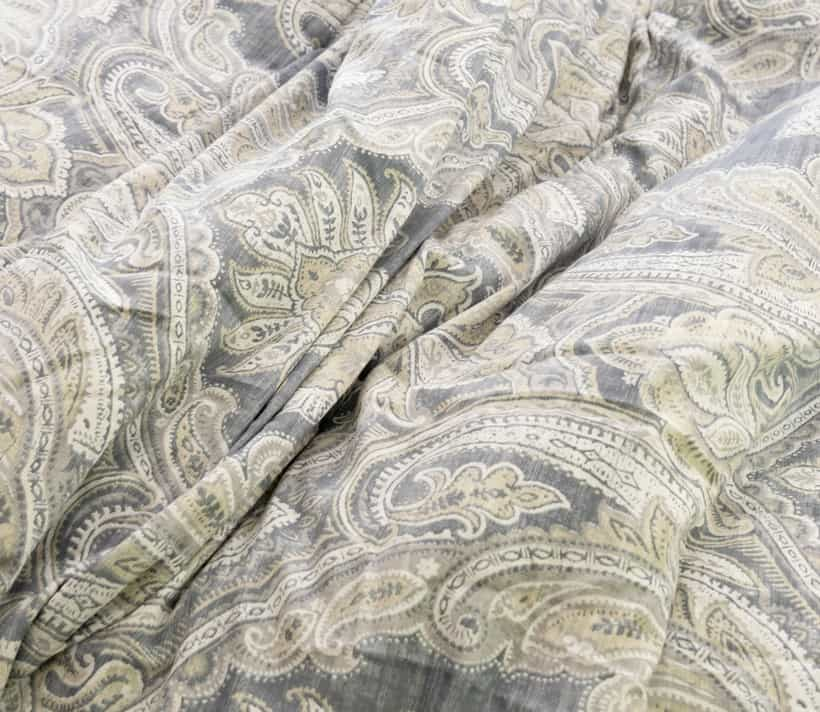 Comforter with gray and off white paisley pattern