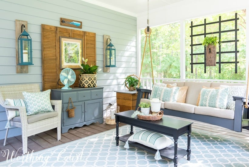 screened in porch decor with a porch swing
