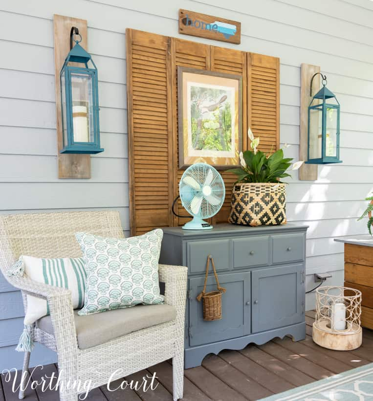 Outdoor chest and small gray chest on a porch.