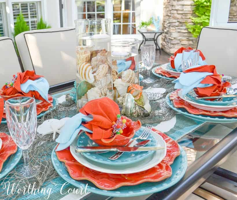 An outdoor table setting in coral and blue.