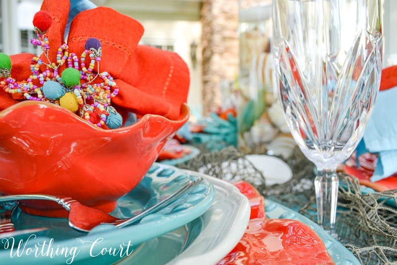 Turquoise and coral dishes stacked together.