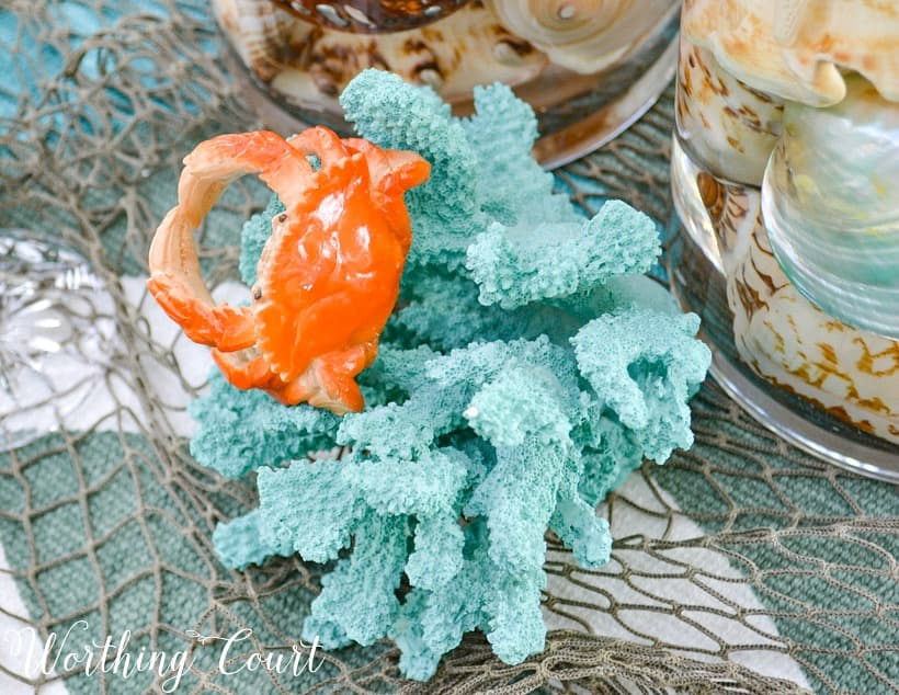 Blue piece of coral with a small fake crab.