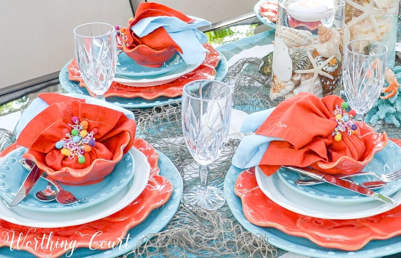 Coral and turquoise plates stacked on top of each other.