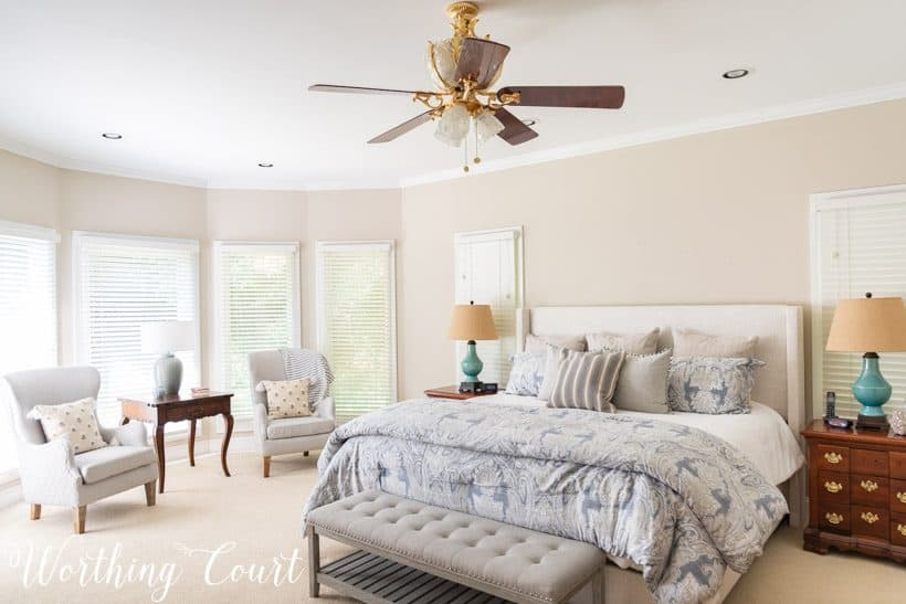 bedroom with neutral walls and neutral bedding