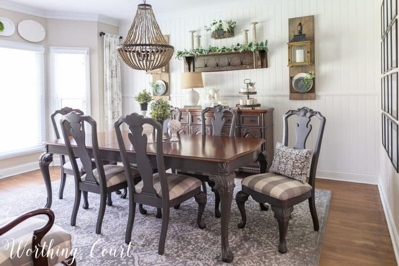 Dining room with white walls and gray painted furniture