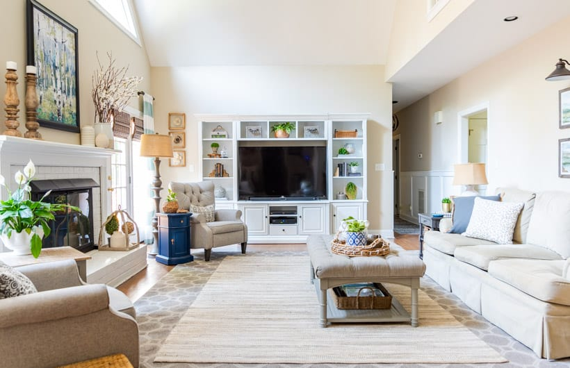 family room with neutral furniture and white entertainment center