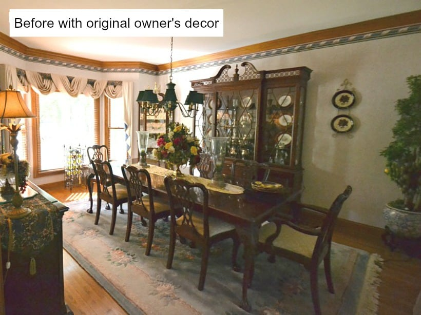 dining room with dated dark furniture