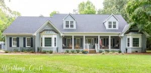 exterior of traditional brick ranch painted gray
