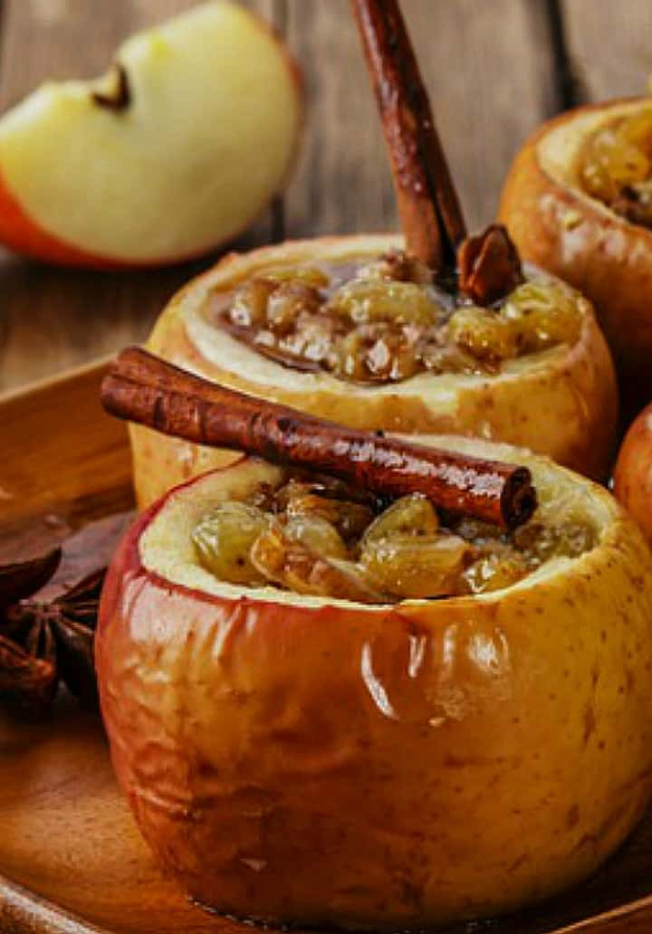 Up close picture of the baked apples with the cinnamon sticks.