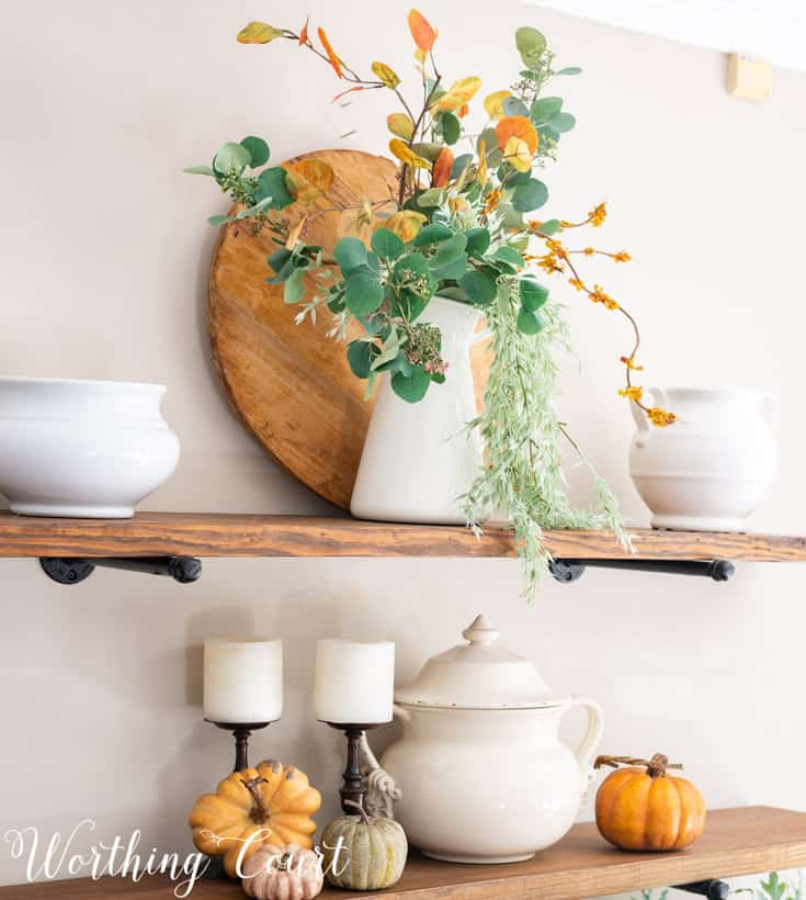 fall decorations on open shelves
